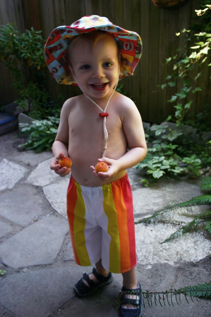 My son wearing rainbow cropped pants from The Vocabulary on Etsy